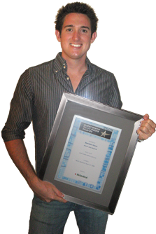 Picture of Damien Viero holding QLD Media Award